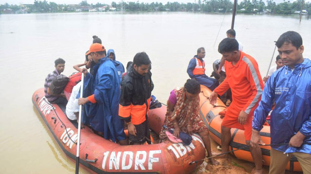NDRF personnel engaged in evacuating people from flood affected areas in Tripura. Image: Indigenousherald