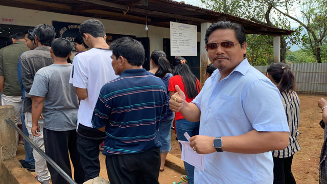 Meghalaya Chief Minister Conrad Sangma in a queue to cast his vote at a polling station. Image: Special Arrangement
